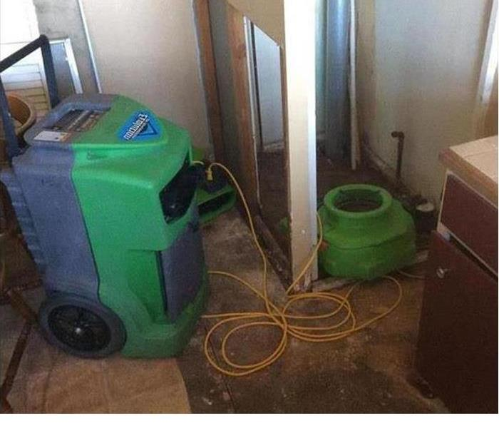 water damaged kitchen with SERVPRO dehumidifiers